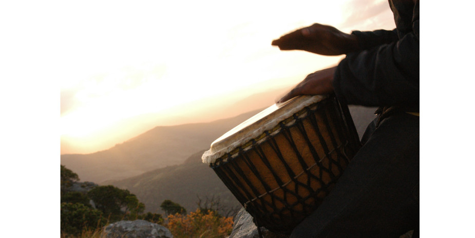 Beating drum on the airstrip, Port St Johns